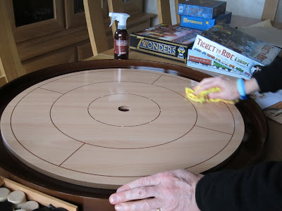 Crokinole - Me waxing the board