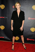 Charlize Theron wearing blackoutfit