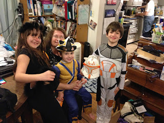 Our three kids and their grandmother in their Halloween costumes