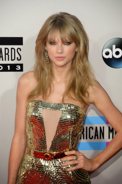Taylor Swift Long Wavy Cut with Bangs Hairstyle