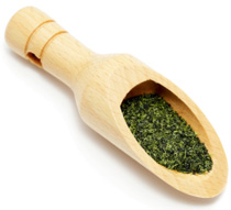 Green Tea Powder in Wooden Spoon