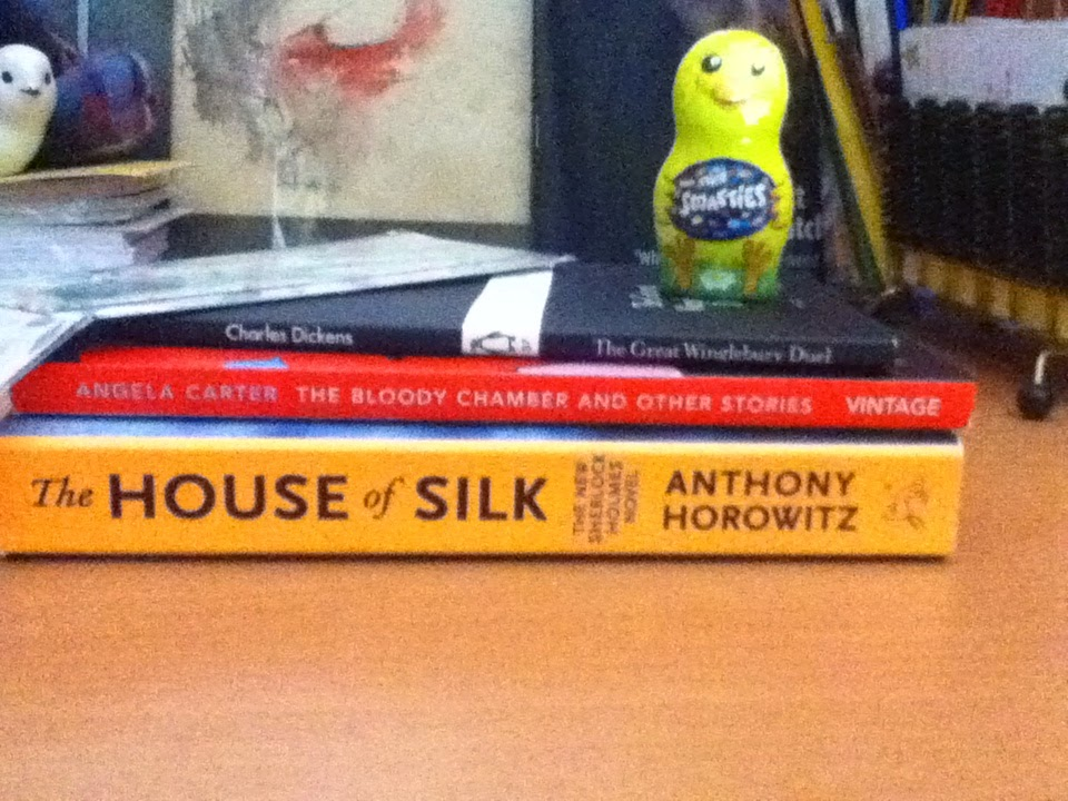 The House of Silk by Anthony Horowitz, The Bloody Chamber by Angela Carter and The Great Winglebury Duel by Charles Darwin in a pile with smarties in a small chocolate chick on top