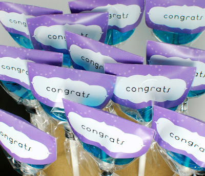 purple congratulations labeled hard candy suckers