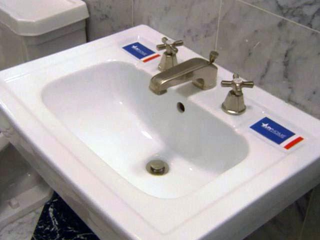 Install bathroom sink