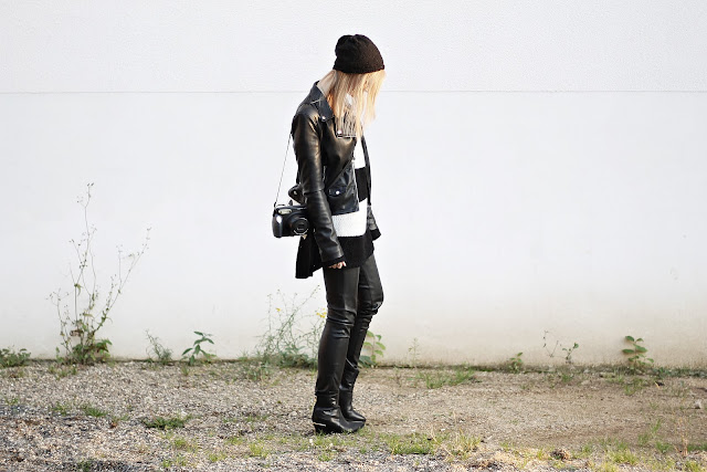 leather pants and oversized block striped knit jumper