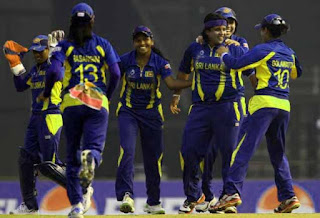 Eshani Lokusooriya of Sri Lanka celebrates with her teammates after taking the wicket of Charlotte Edwards.