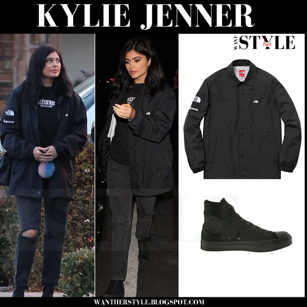 Kylie Jenner in black anorak north face supreme jacket and black ripped jeans what she wore