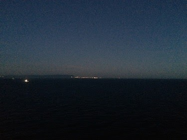 Chuck and Lori's Travel Blog - Coast of Africa at Night from Norwegian Epic