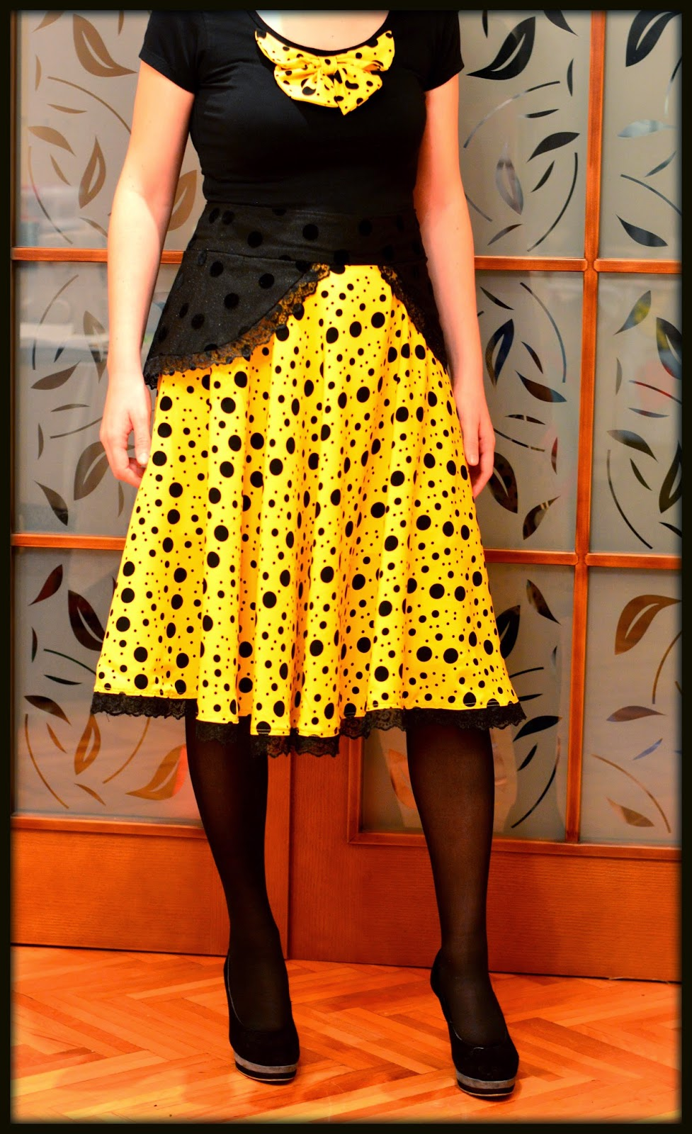 Yellow and black polka dots circle skirt with bow decorated t-shirt and lace hem