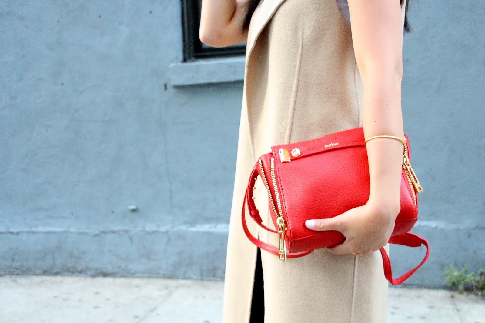 fall transition outfit Zara camel sleeveless trench waistcoat J Brand Mercy jeans Botkier red bag Tibi mules