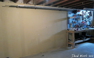 how to hang a wall peg board, work area for pegboard