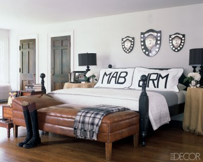leather bench, masculine bedroom, tailored bedding, warm interiors, art in the bedroom