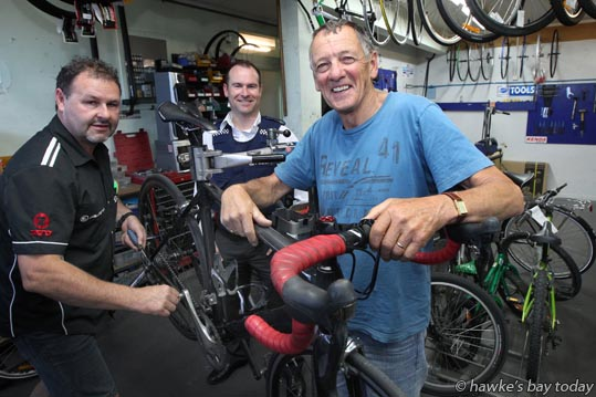 L-R: Steve Humphreys, owner, Pedal Power, Taradale, Napier; Constable Ben Dalton; Peter Winstanley, whose bike was stolen and recovered. photograph