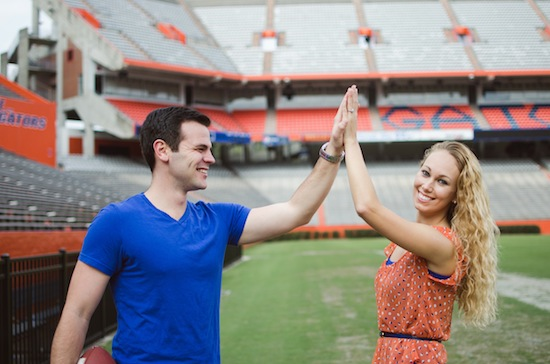 couple high fiving during their engagement session