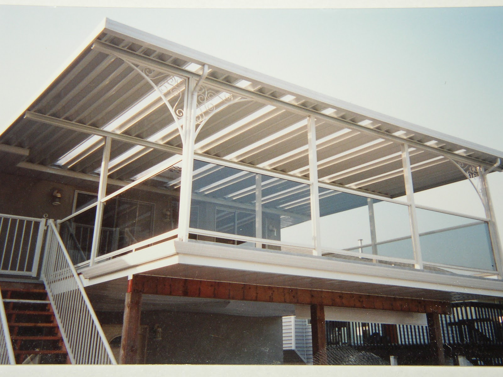 patio cover awning with mix of aluminum pans and skylights