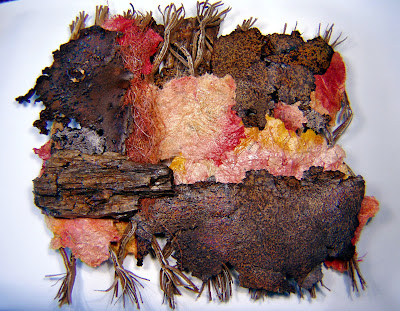 handmade paper, rusty metal, found objects