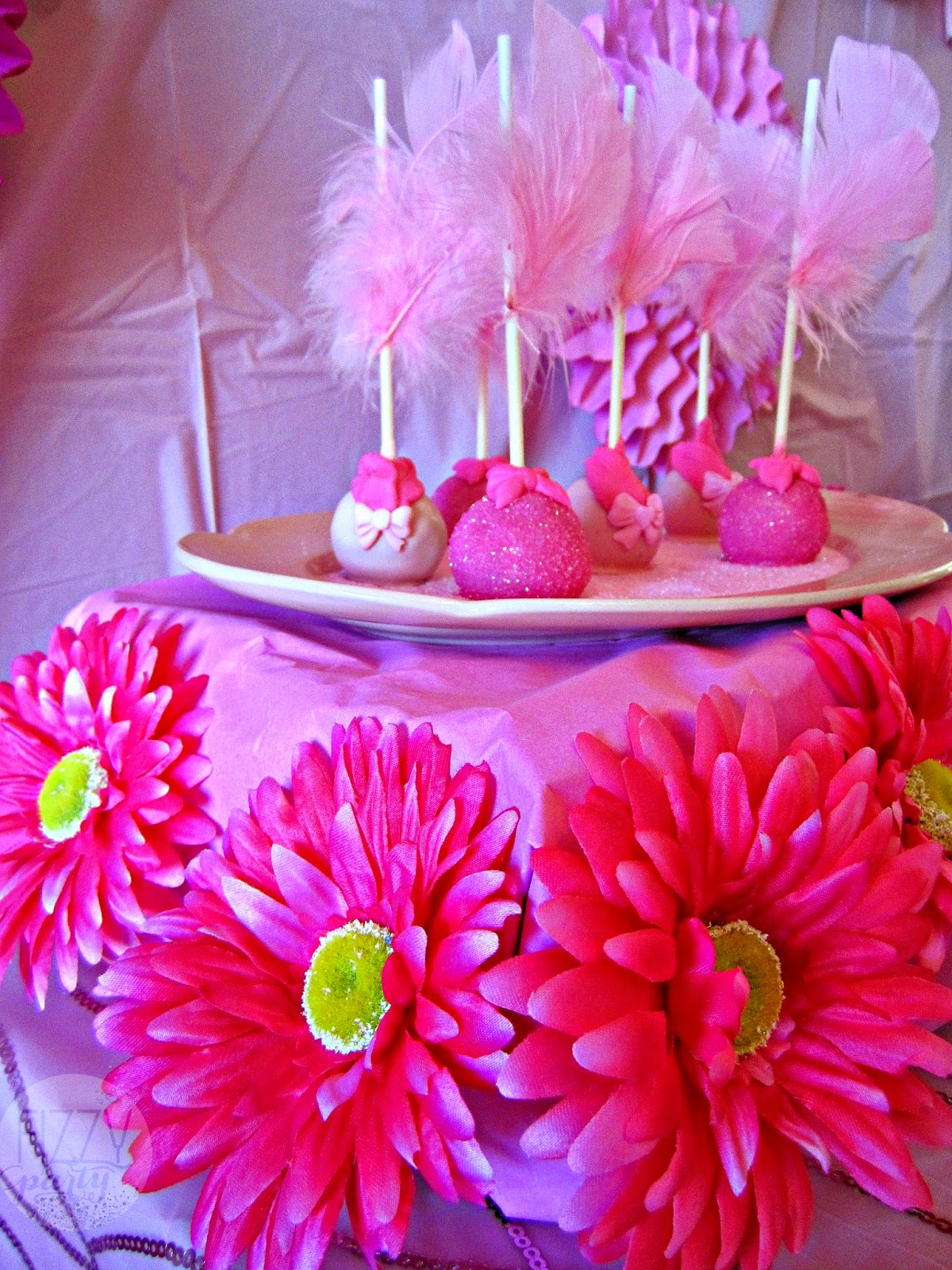 Pink party cake pops by Kima Konfections