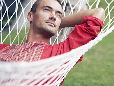 How Men Get Over A Break Up - man on a swing - Dreamy guy