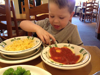 dylan couldnt decide so he had ravioli and macaroni and cheese with a side of broccoli of course i had to sample each for my review hehe - Olive Garden Review