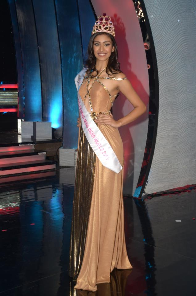 Navneet Kaur Dhillon, winner of Pond's Femina Miss India 2013, posing for the shutter-bugs after winning the title during the Ponds Femina Miss India 2013 beauty pageant held at Yash Raj Studios in Mumbai on March 24, 2013.