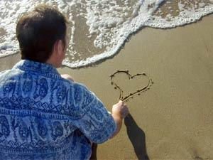 Is Love Painful? - pain - man draw heart on sand