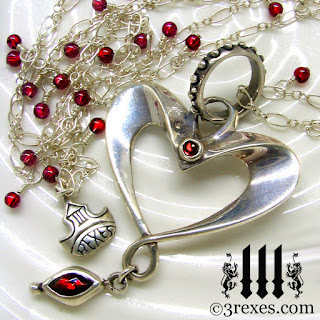 silver heart necklace with garnets