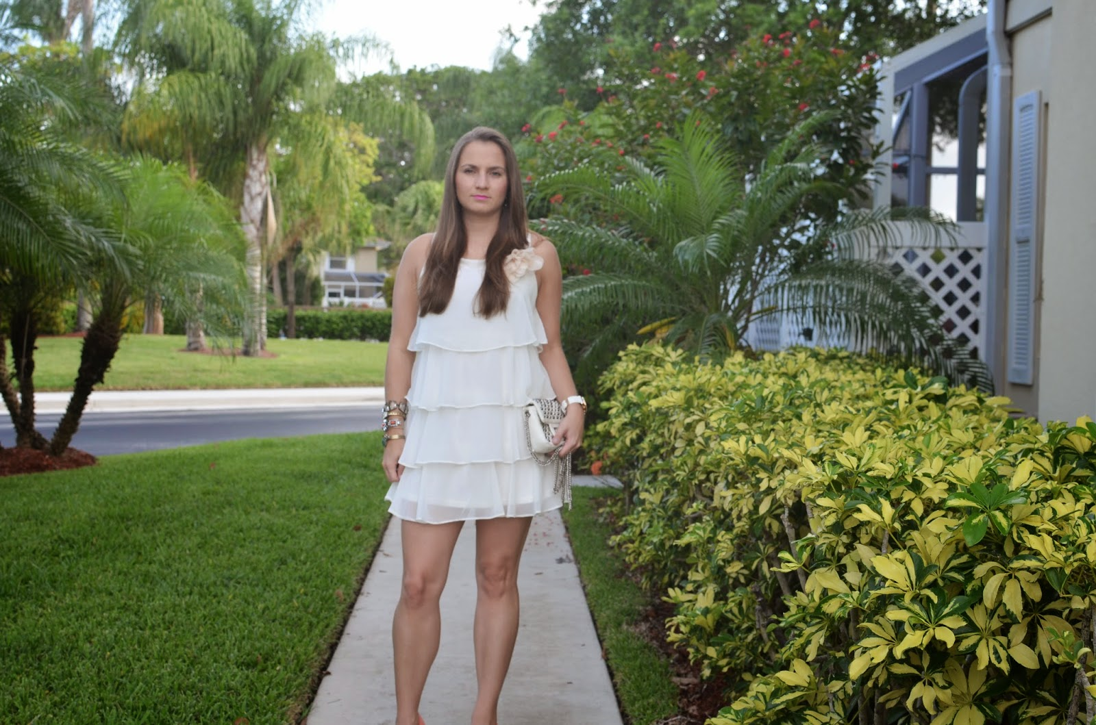 white dress - arm party - Emma & Sophia - studded clutch - coral pumps