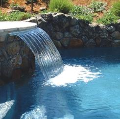 Ara construcciones en general decora tu piscina con for Modelos de piscinas con cascadas