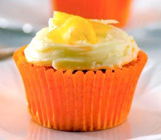 Orange cupcakes with orange-flavoured sponge, orange icing (Frosting) and orange segment garnish.