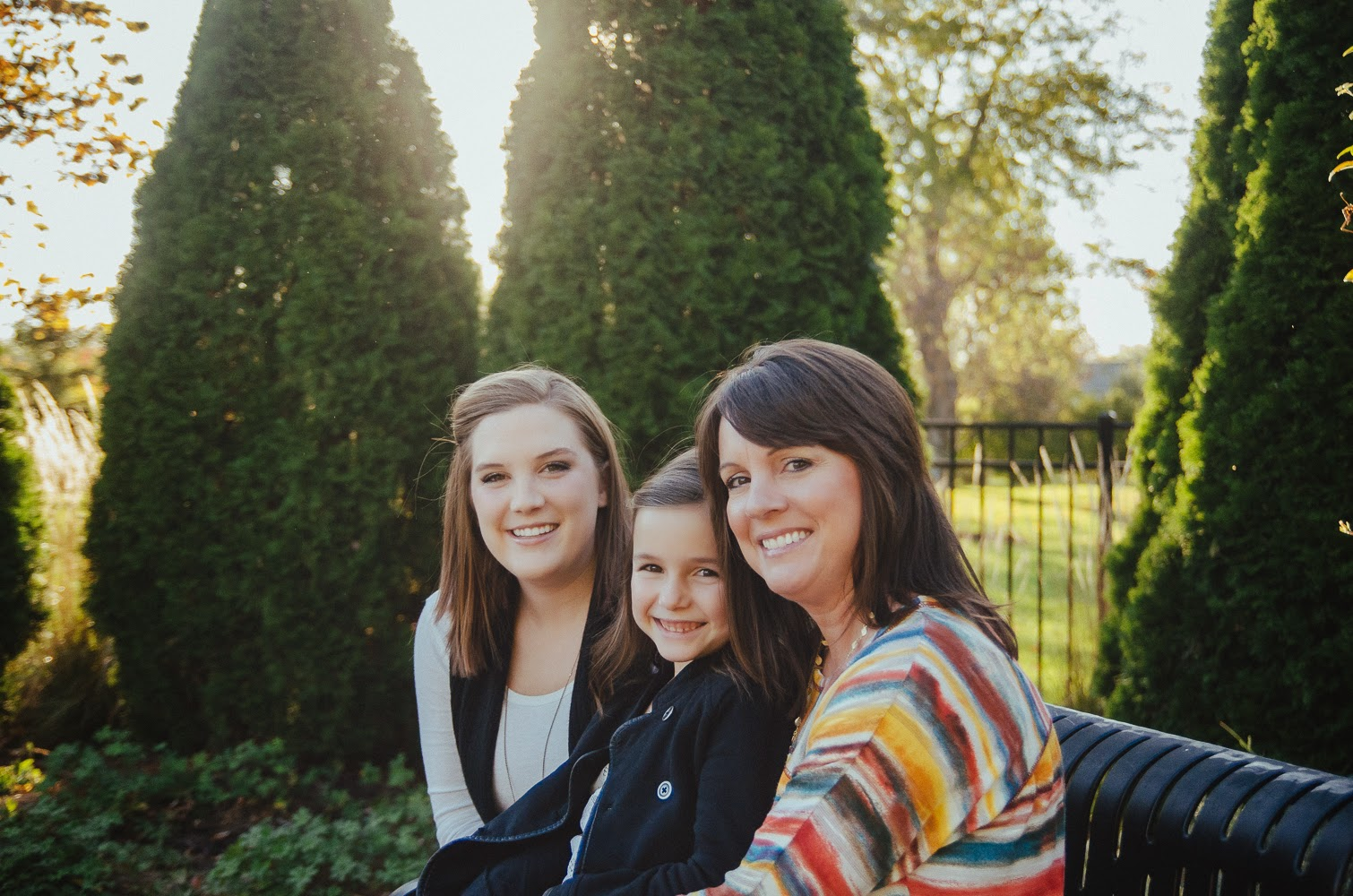 backlit photography in Indianapolis of mother and daughters in autumn