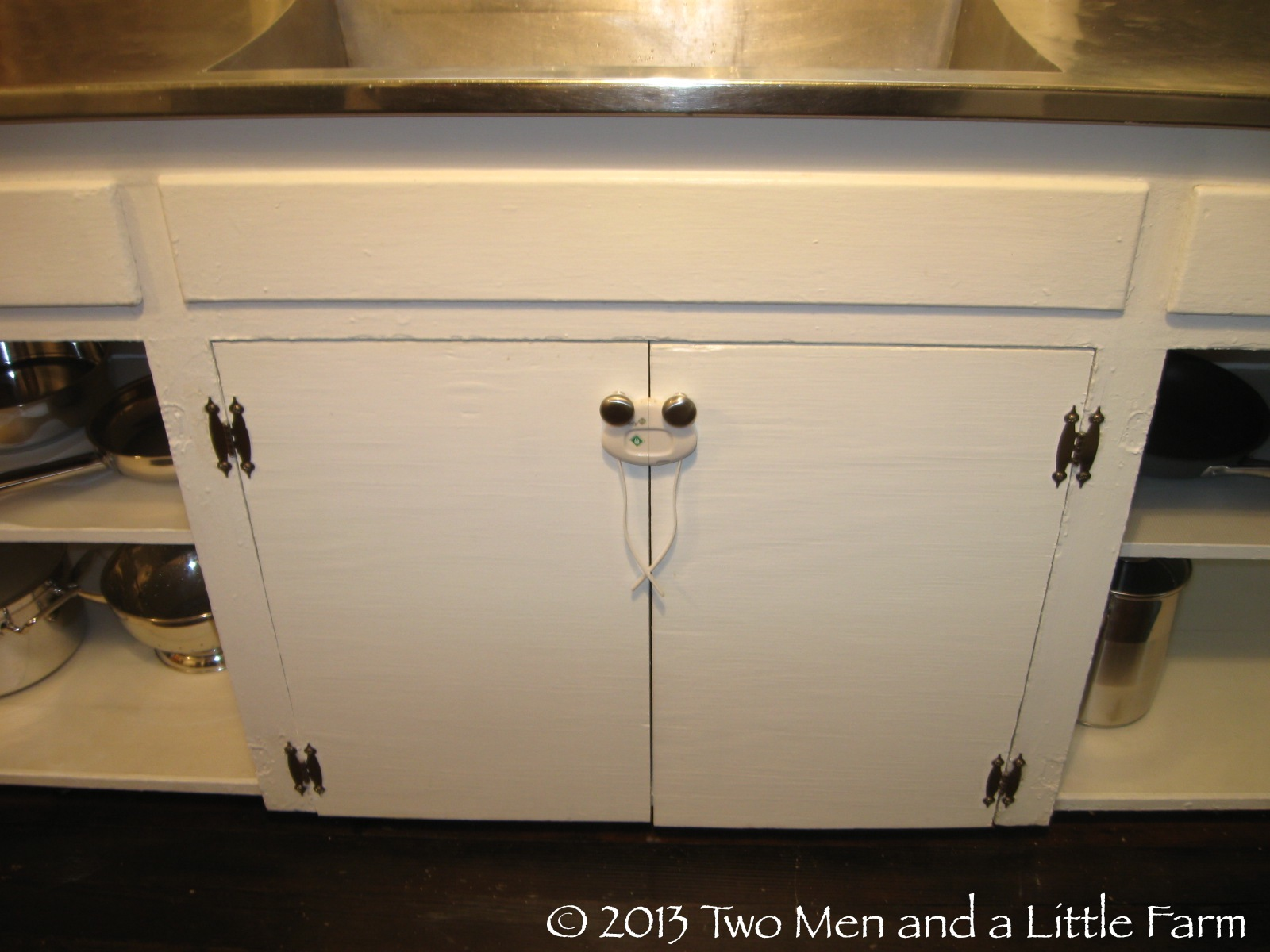 Two men and a little farm ants in my pants and other for Child lock kitchen cabinets