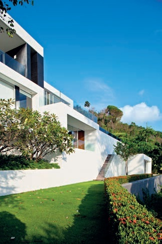 The residence steps down the steep northeast facing cliff