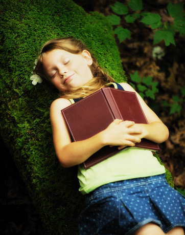 girl asleep with book
