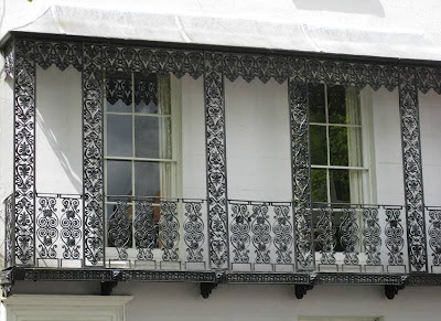 Decorative balcony and two long sash windows