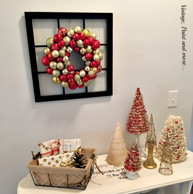 vintage French table with ribbon, burlap and paper trees, ornament wreath and vintage chicken wire window