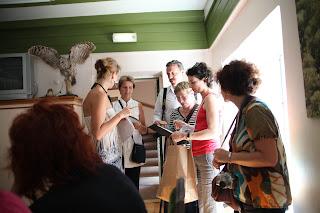 Photo of Kaia explaining tasks to French speaking team