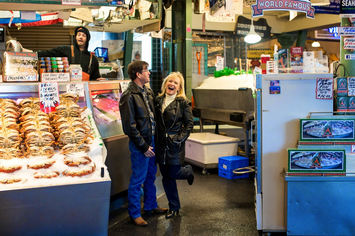 Iconic fish stand engagement photo for Joan and James - Patricia Stimac, Seattle Wedding Officiant