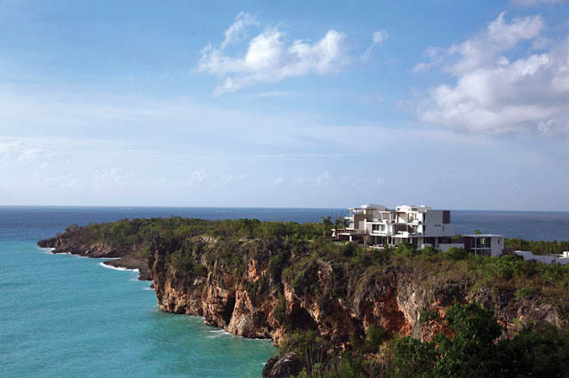 Two modern villas on a cliff overlooking the ocean