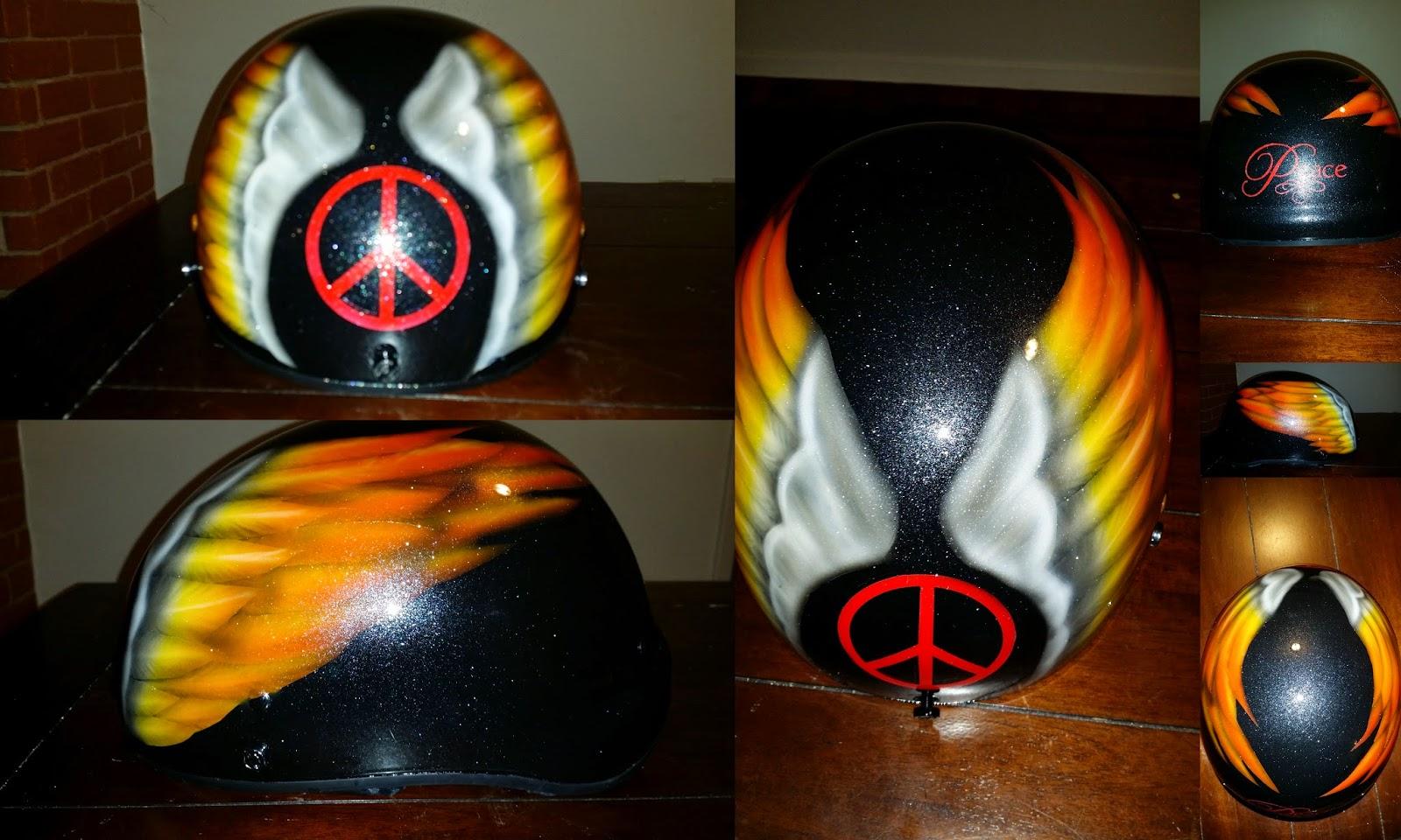 custom painted motorcycle helmet with harley wings and peace