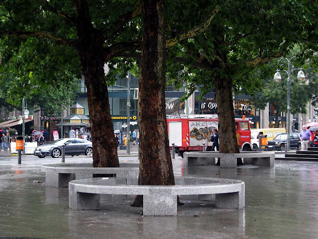 Bench in the rain, Breitscheidplatz, Charlottenburg, Berlin