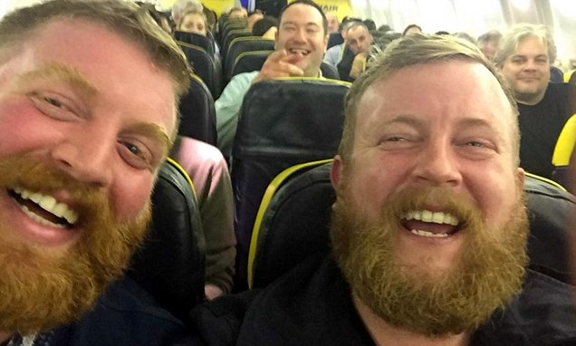 Britain is going crazy over two strangers, who look like identical twins, and found themselves sitting next to each other in a plane.   Neil Douglas, from Glasgow, took a Ryanair flight last Thursday. Sitting next to him was a stranger looking exactly like him.