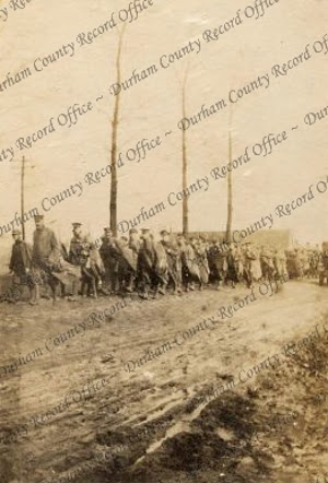 Soldiers of the 7th Battalion, The Durham Light Infantry, marching along a road in the Western Front, c.1914 - 1918 (D/DLI 2/7/18(223))