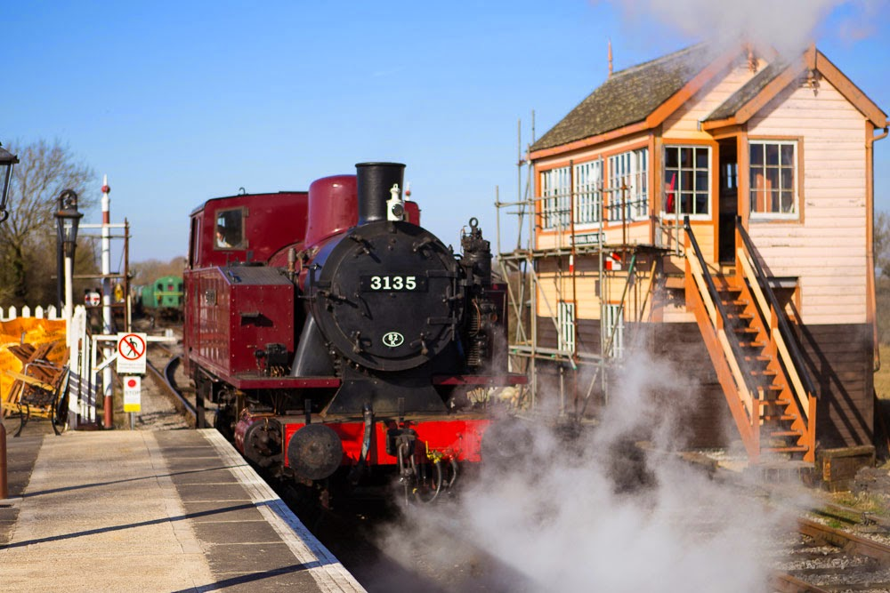 Spartan steaming past signal box