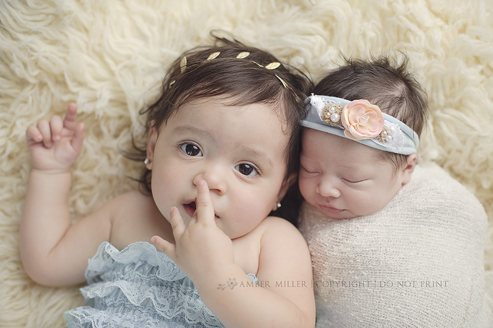 newborn baby girl and big sister