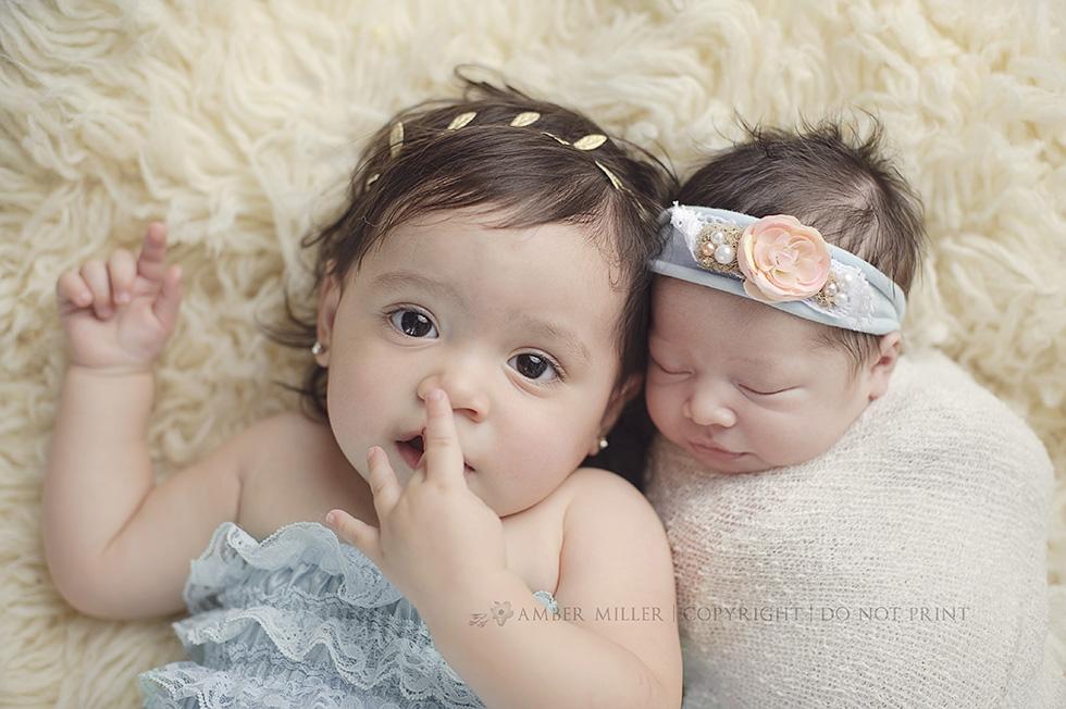 newborn baby girl and big sister