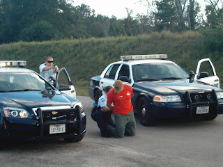 Officers Paul Caughman and Sylvie Acklin simulate the arrest of a suspect at the academy.