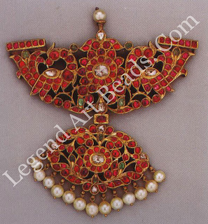 PADAKKAM Tamil Nadu 191 century Private collection Rubies from Burma and diamonds from Golconda combine in this pendant with two peacocks with a fan shaped pendant