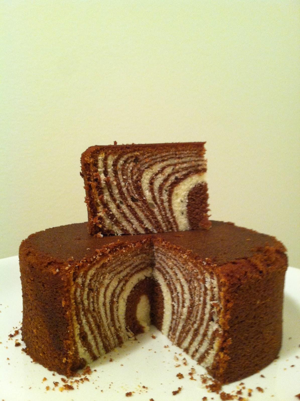 below slice of zebra cake atop the cake