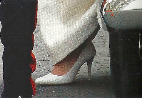 A Closeup Of Kates Wedding Shoes They Have Handmade Lace Over White Satin To Match The Dress