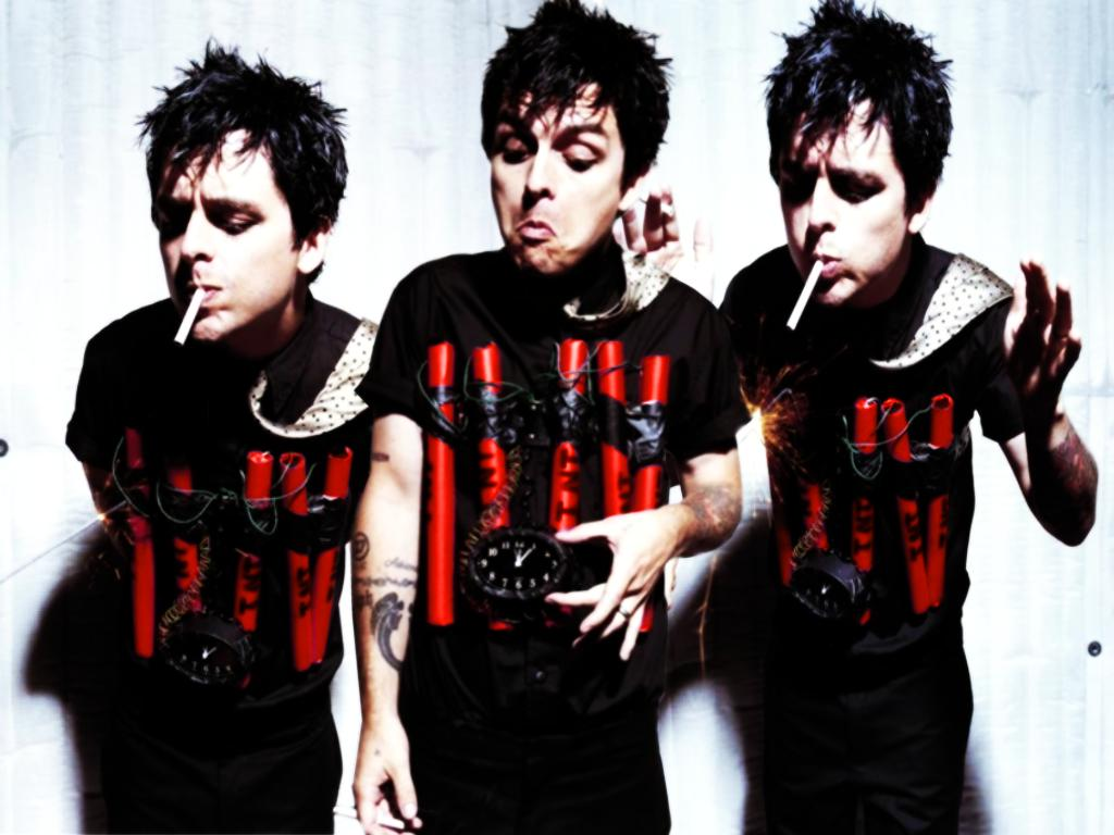 http://1.bp.blogspot.com/-3KqE3KZzNTc/TtxIpkbUsgI/AAAAAAAAAos/N6G4sZ42hS8/s1600/green-day-background-7-766312.jpg